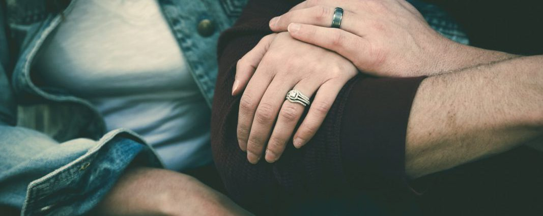 man and woman couple wearing their silver couple bond ring